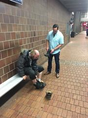NFTA officer buys boots for homeless man