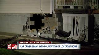 Hole left after car crashes into Lockport home