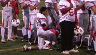 Jamestown football player takes a knee
