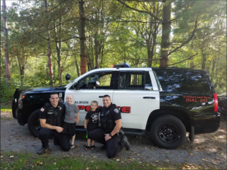 Albion police surprise young cancer patient