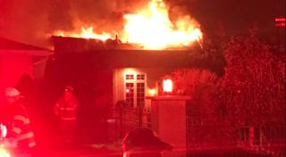 Flames burst through roof of Cheektowaga home