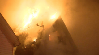 Buffalo fire destroys building, damages another