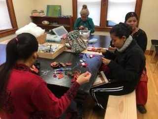 Refugee community sticks together by stitching