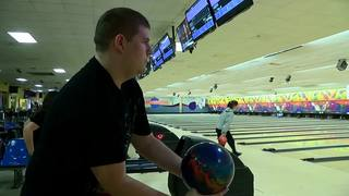 Kenmore East's Kobi Wiewiorski bowls his way...