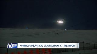 Air and road travel difficult much of Tuesday