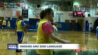Swishes and sign language: St. Mary's School...