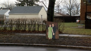 Mystery painted portraits show up on NF street