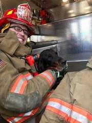 Firefighter gives surrendered dog a new home