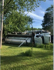 Septic tanker tips, driver charged