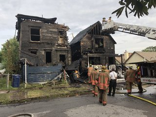 Crews investigate two-building fire on east side