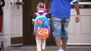 Fathers take part in Take Your Kid to School Day