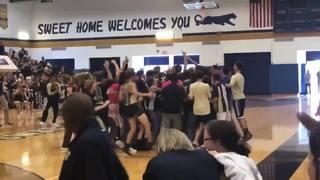 Teacher hits half-court shot, wins student a TV